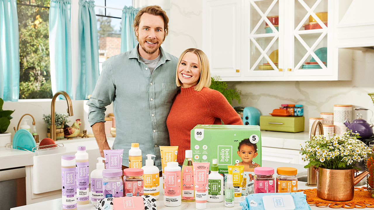 Kristen Bell and Dax Shepard posing with all the products from their Hello Bello brand
