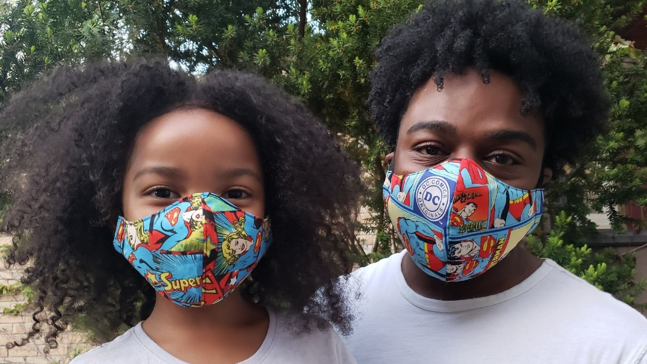 father and daughter wearing matching masks