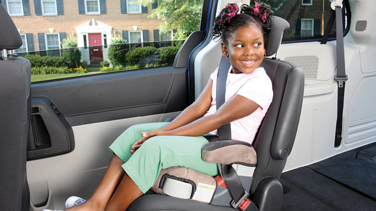 Child who made the transition to booster seat at age six