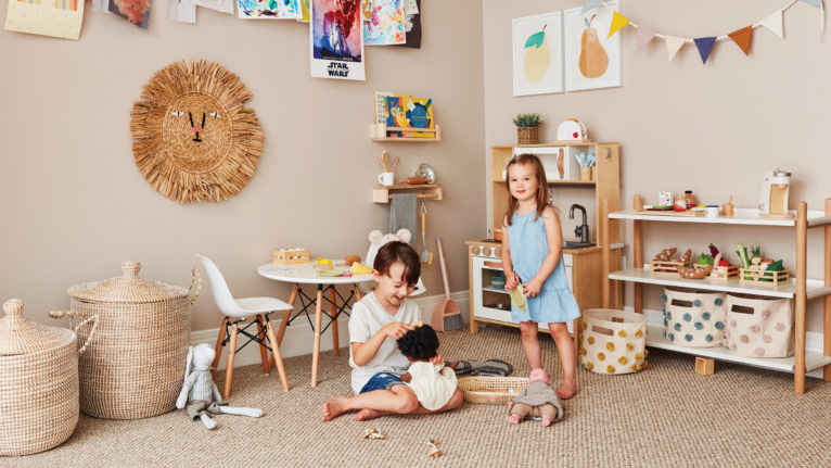 two kids playing in an organized playroom