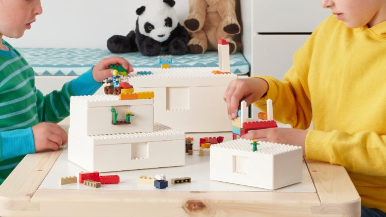 kids playing with lego on a table