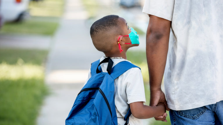 Child on his way to public school with parent