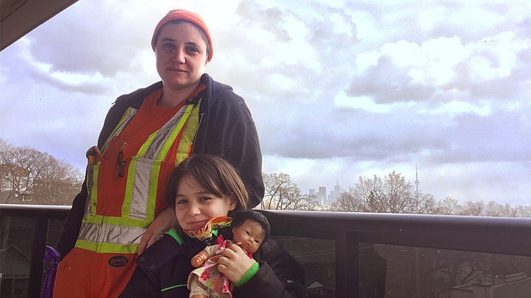 mom in construction clothing with her daughter