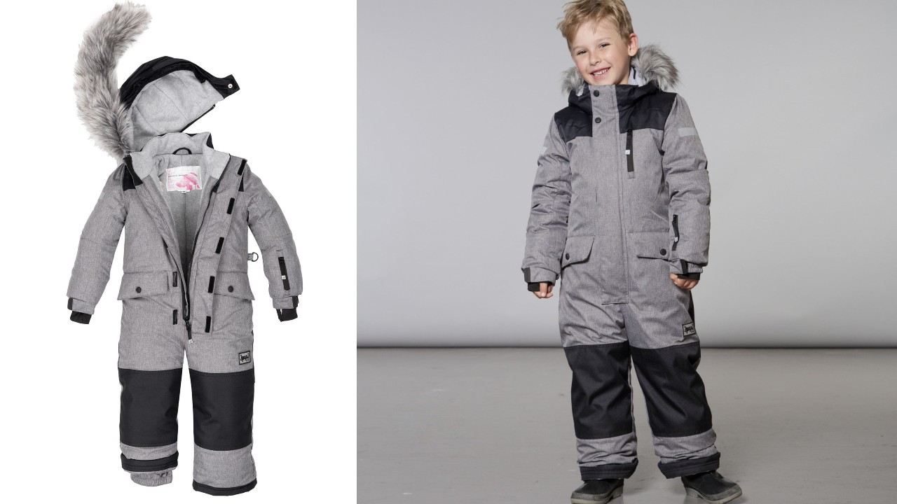 young boy wearing grey one-piece snowsuit