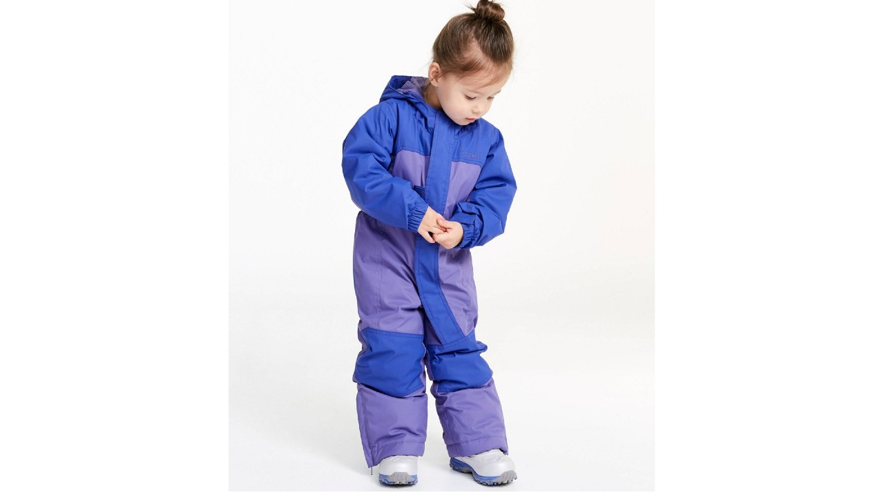 small girl in cozy snowsuit