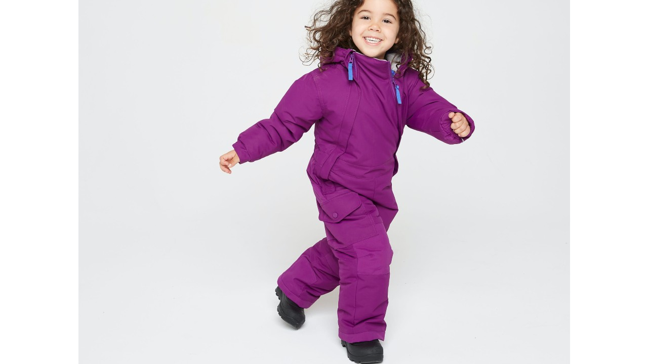 Young girl in full piece snowsuit