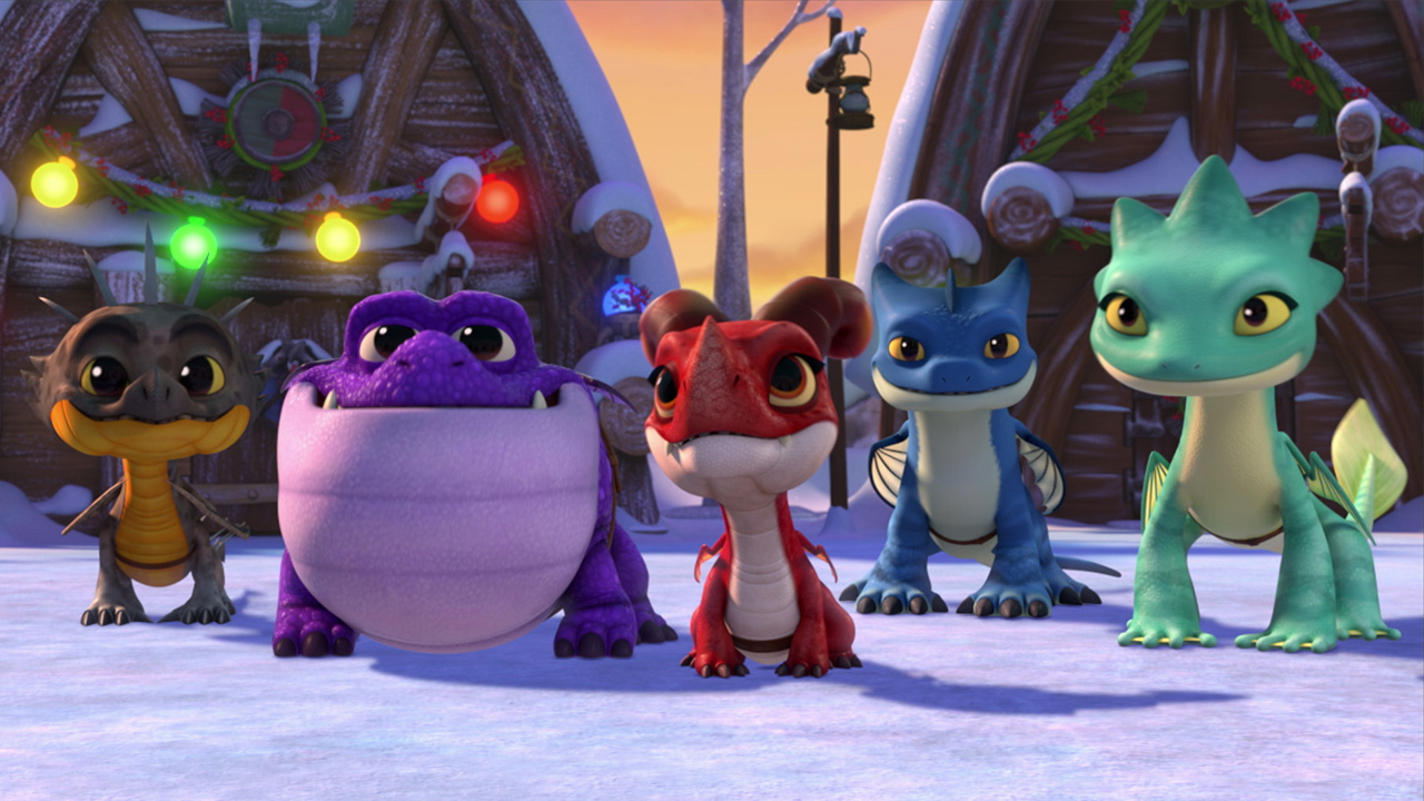 image of animated young dragons standing in a snowy village decorated for the holidays