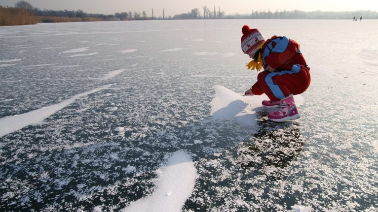 photo of young girl on the ice