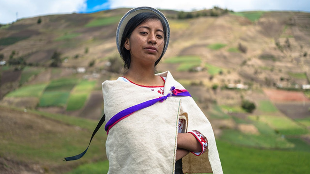 Peruvian young girl in a field looking proud and strong