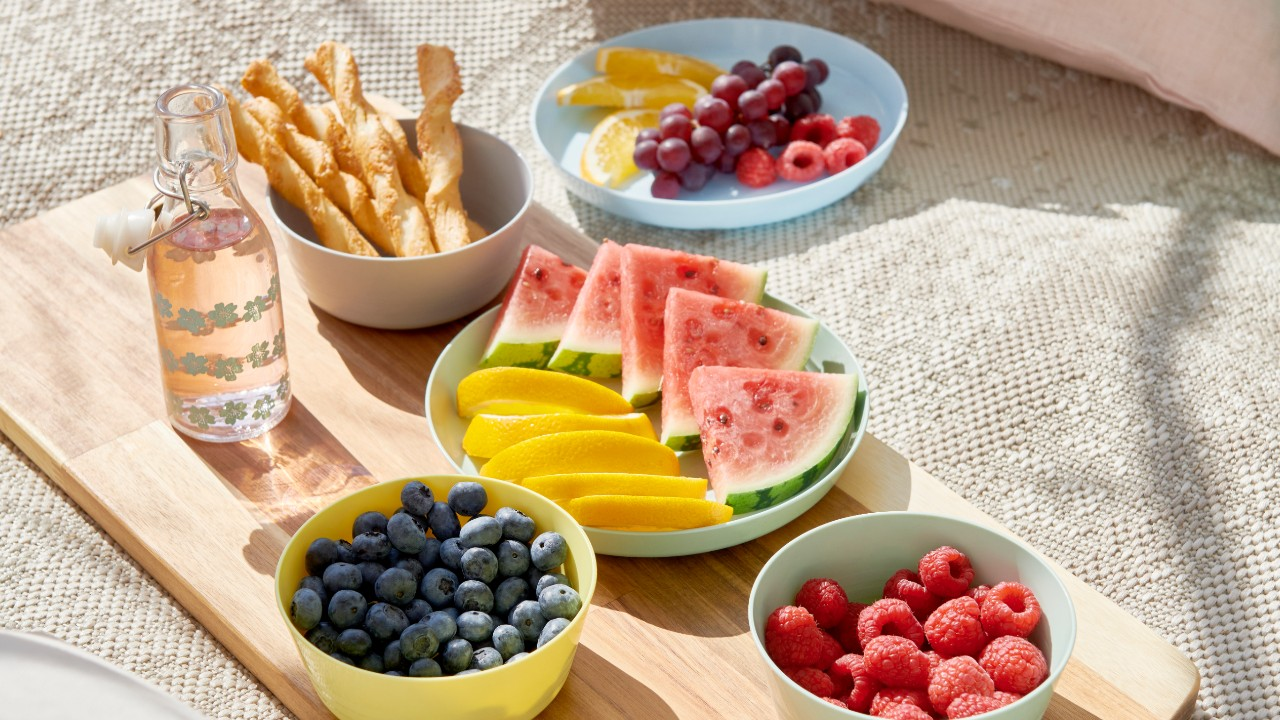 picnic of fruit with pastel kid dishes