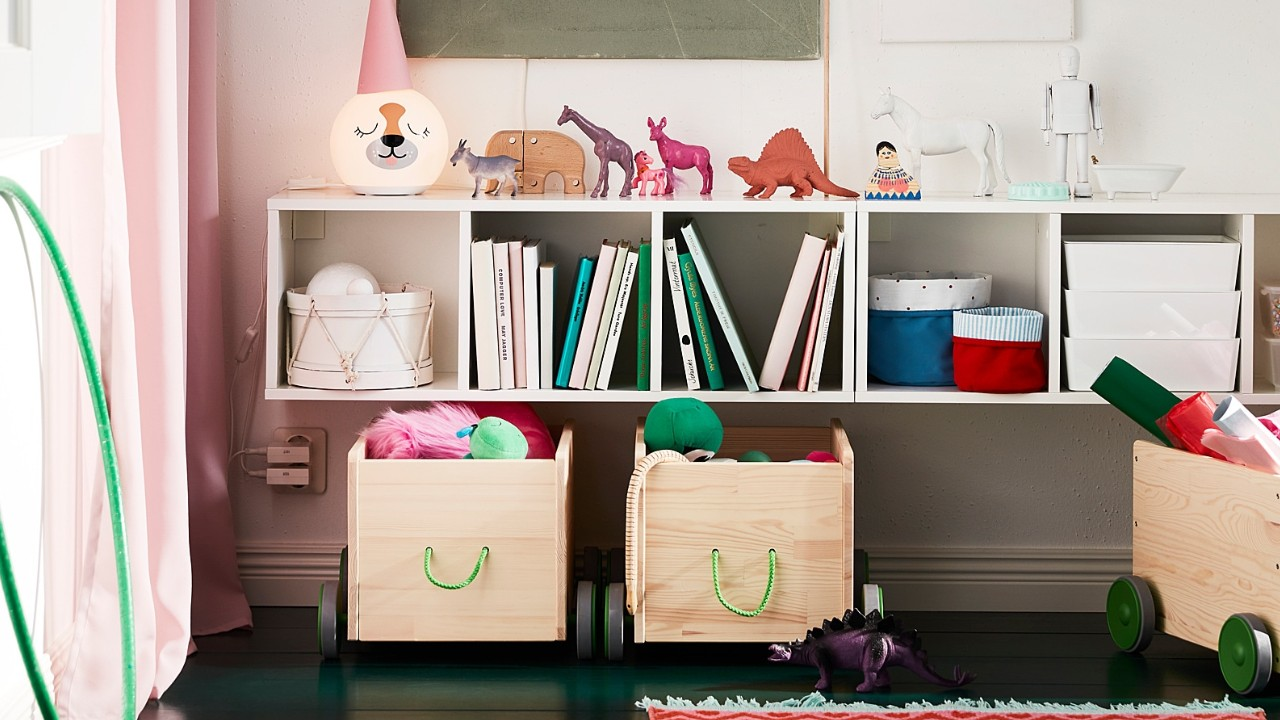 kids shelving unit filled with books and toys