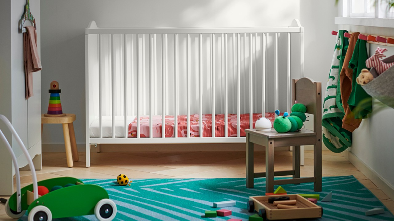 crib with colourful nursery accessories