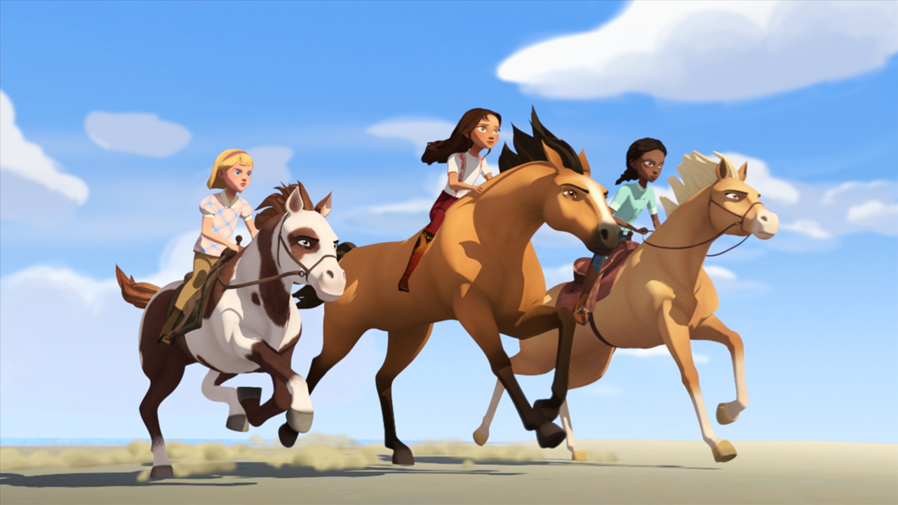 A still from Spirit Riding Free: Ride Along Adventure showing three animated kids riding horses across a desert