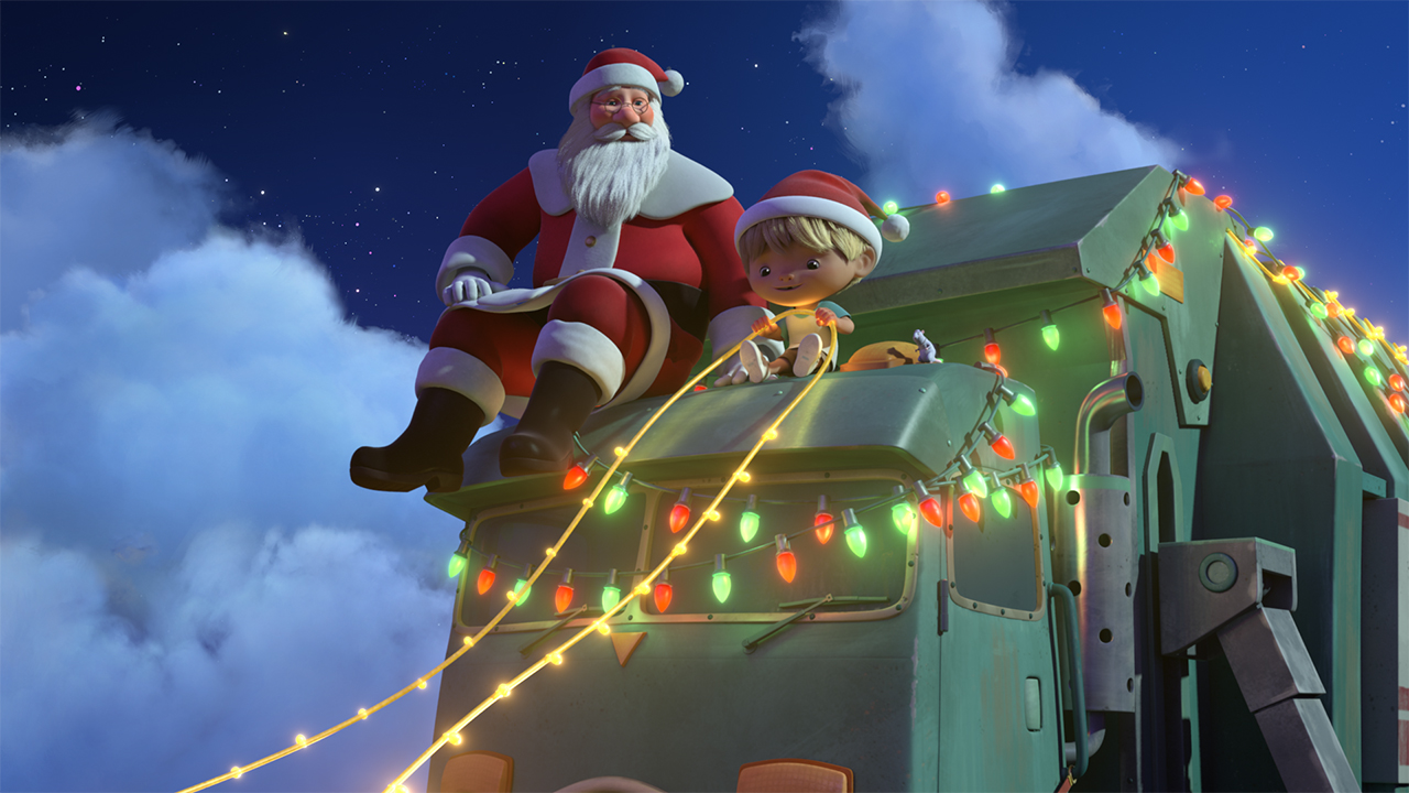 A still from A Trash Truck Christmas showing Santa and a kid riding on a trash truck covered in Christmas lights