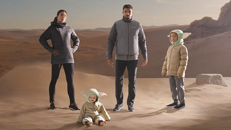 family in Star Wars themed clothing on movie set background