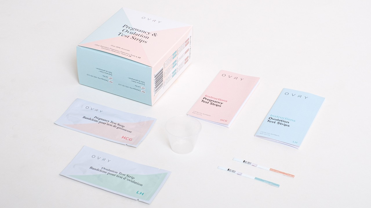 colourful boxes with ovulation and pregnancy test strips