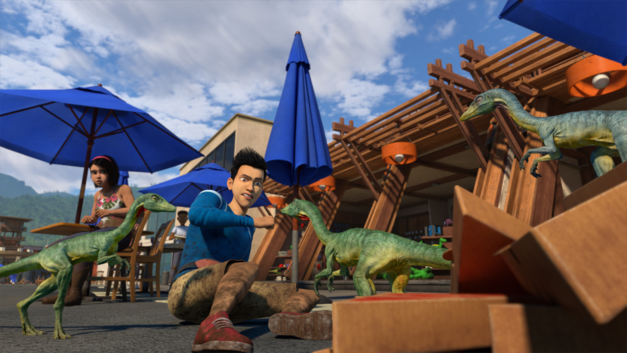 A still from the animated show Jurassic World Camp Cretaceous showing a teen boy being surrounded by a group of small raptors in an outdoor dining area