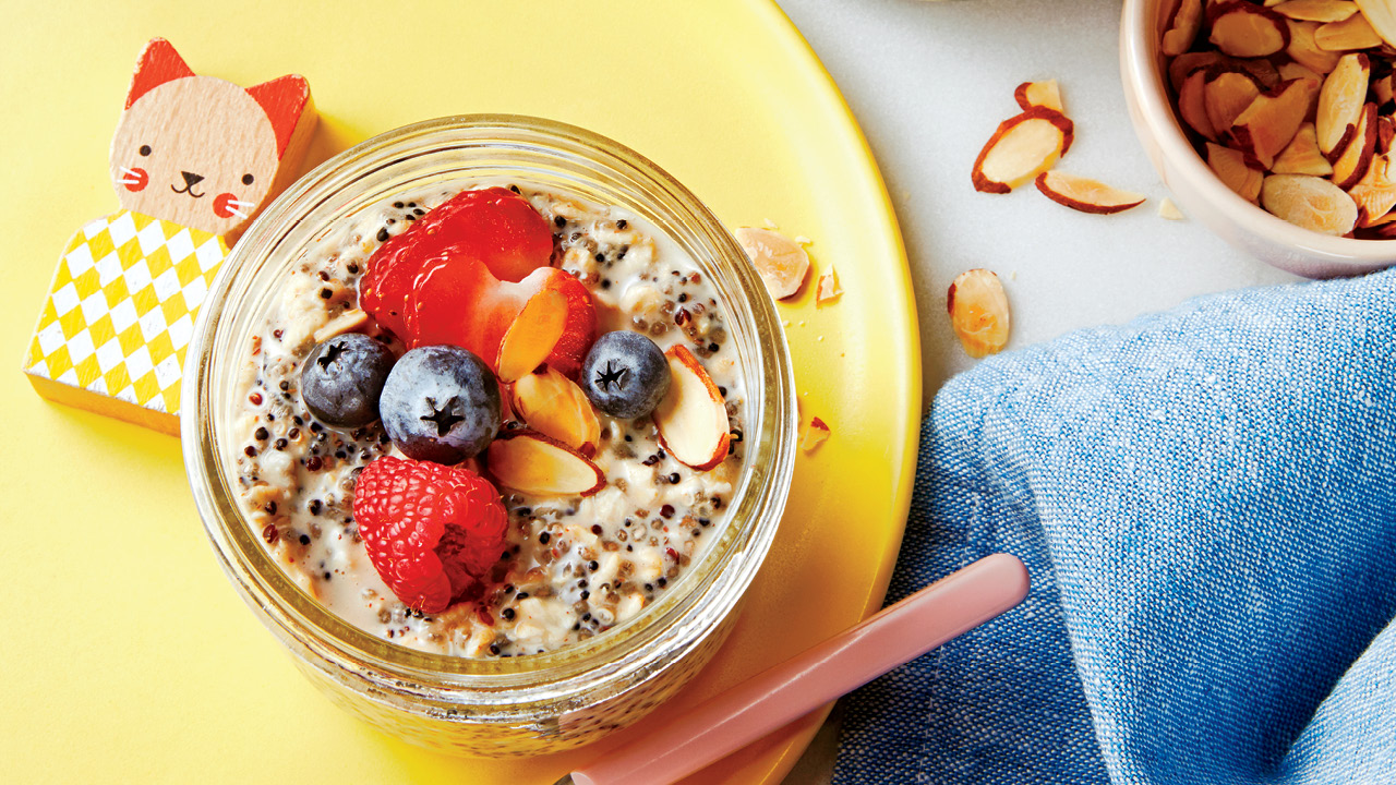 small mason jar with overnight oats topped with fruit