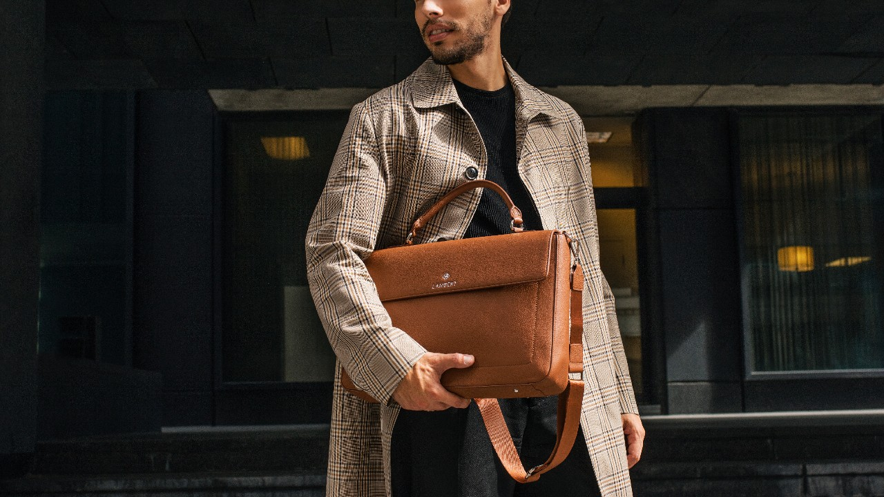 stylish man holding tan briefcase