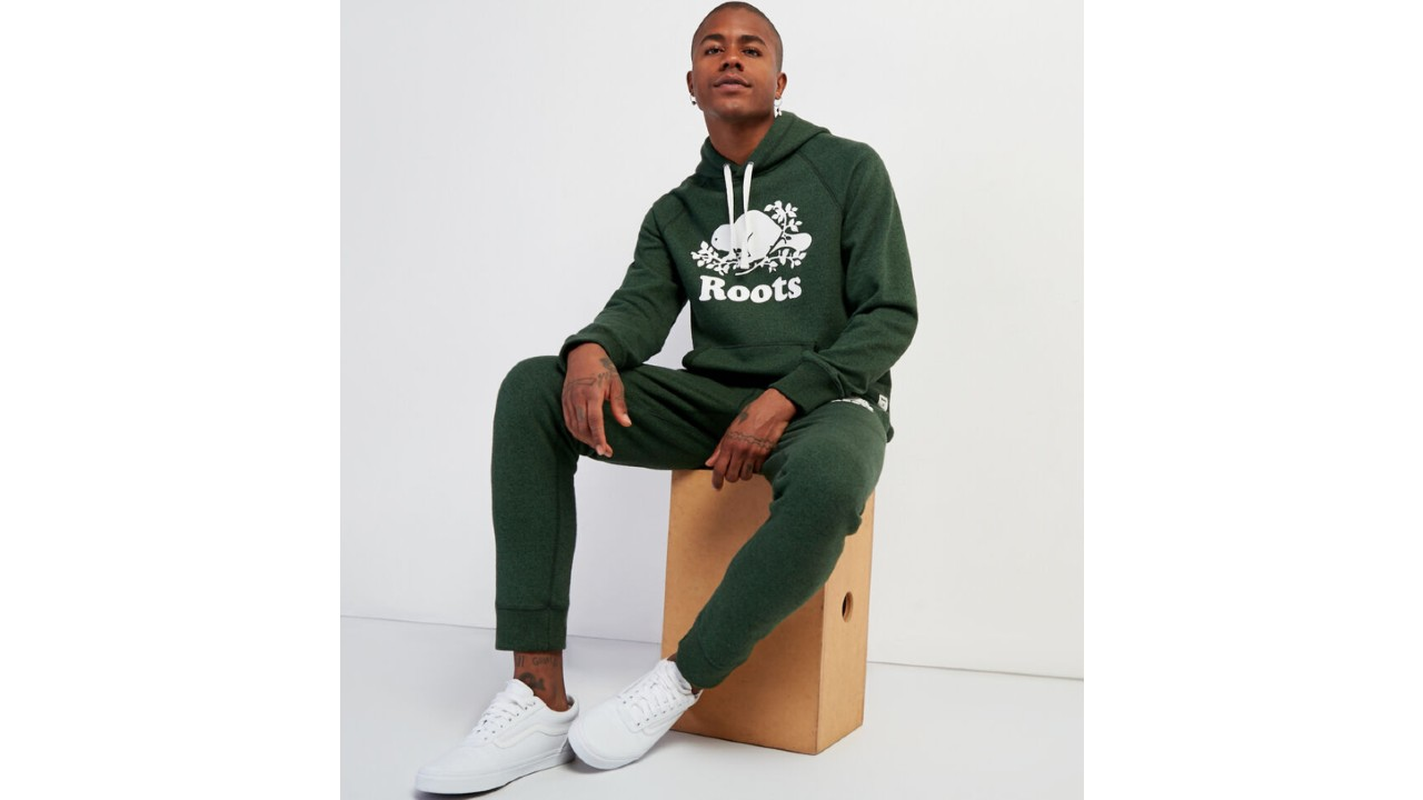 man wearing forest green track suit