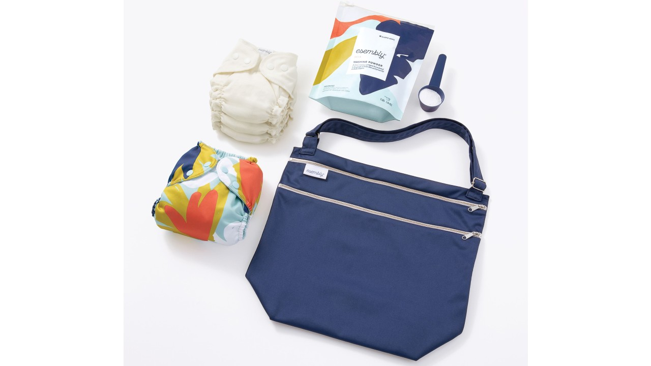bag with reusable diapers and laundry powder