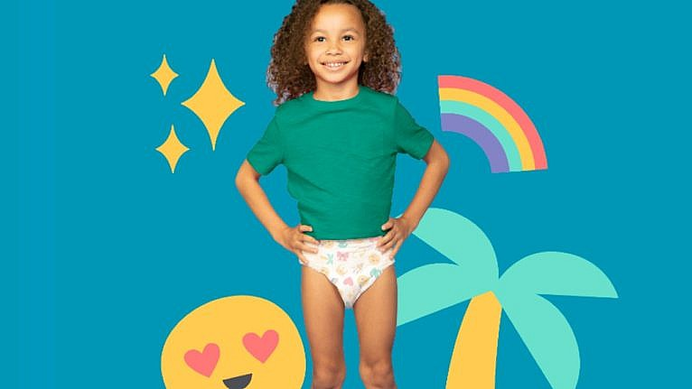 young kid wearing training diaper on coloured background