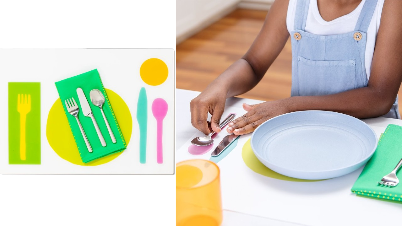 kid setting table with colour-coded placemat