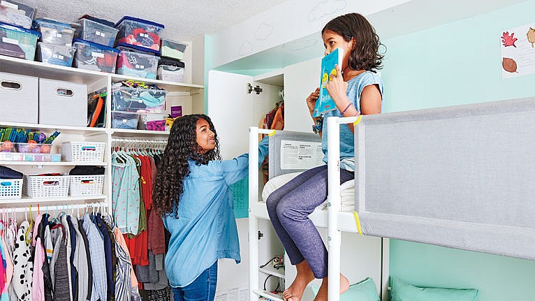 Photo of a teen and her younger sibling in their shared bedroom