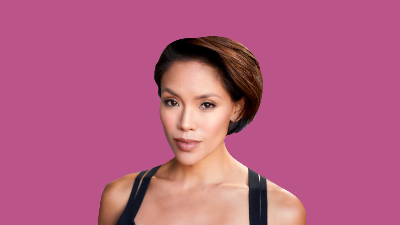 A head shot of Workin' Moms actress Jessalyn Wanlim in front of a pink background