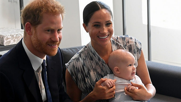 Prince Harry and MEghan with baby Archie in her lap during their tour of Australia and New Zealand for a story on the couple expecting their second child