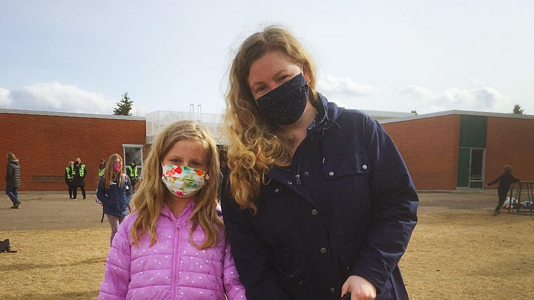 Photo of the author and her daughter in the school yard