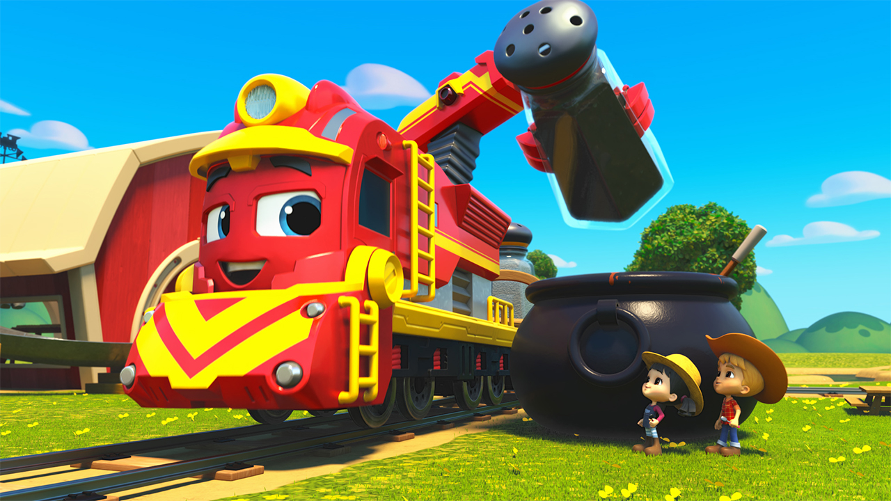 Still from Mighty Express showing a train engine sprinkling something into a big cauldron