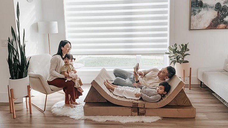 Photo of a family lounging and reading books on a modular play couch
