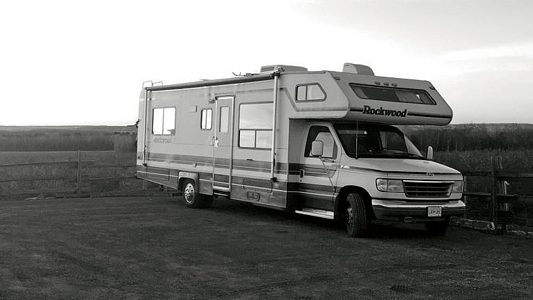 Photo of an RV parked in front of a field