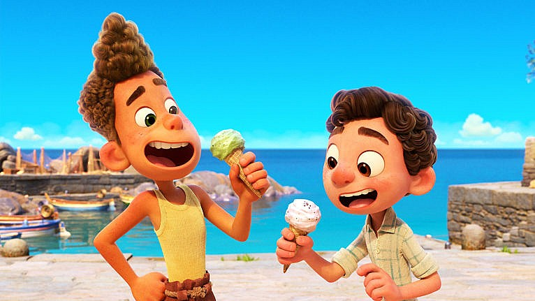 Still from Luca showing two animated kids eating ice cream by the shore