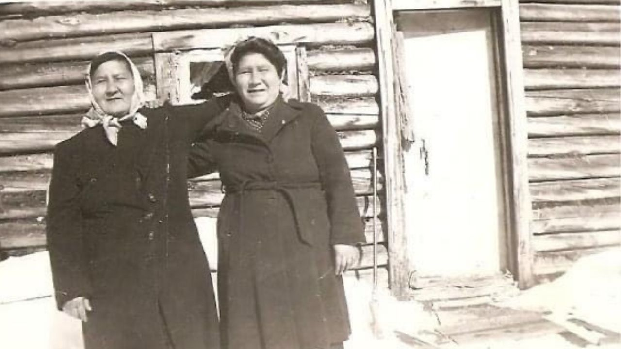 two women with their arms over each other's shoulders