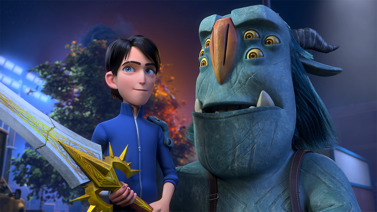 A computer-animated still from Trollhunters Rise of the Titan showing a human with a sword standing next to a monster with six eyes