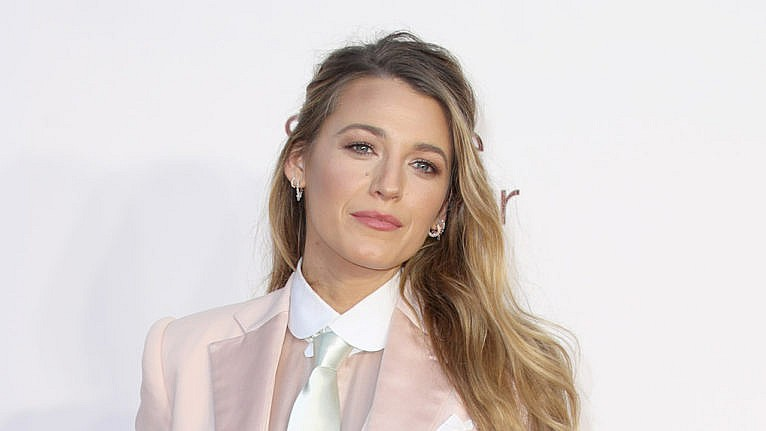 blake lively posing on a red carpet