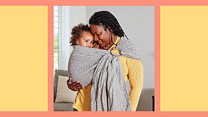 Photo of a mom carrying her toddler in a wrap baby carrier