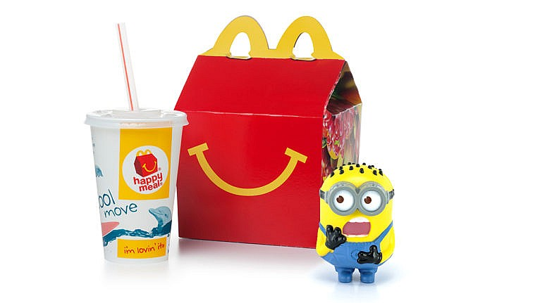 photo of a happy meal box and drink with a plastic minion toy looking shocked