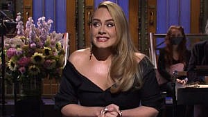 Photo of Adele nervously smiling while doing her monologue on Saturday Night Live